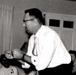 Dad playing charades in 1958