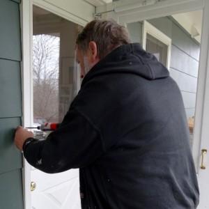 Phil installing the door bell/light